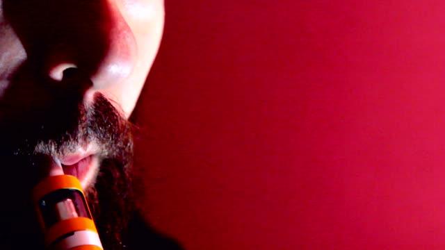 Man with beard vaper smokes vaping closeup video