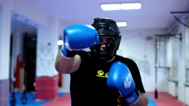 Man with boxing equipment video