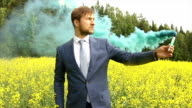 man with colored smoke video