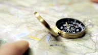 Man with compass and map planning video