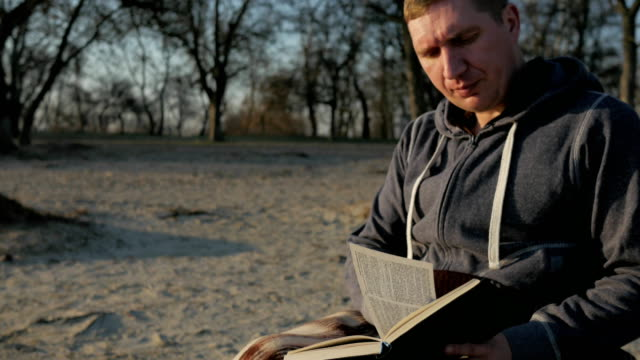 man with disabilities reads holy scripture, an invalid in wheelchair with holy book, prays disabled person, sick person holds bible video