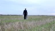 Man With Easel And Canvas In The Field video