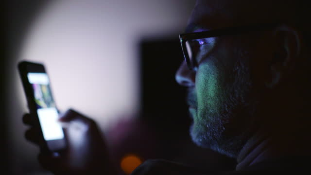 Man With Glasses Using Smartphone Indoor video
