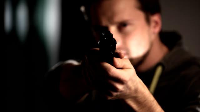 Man with gun looking at camera. video