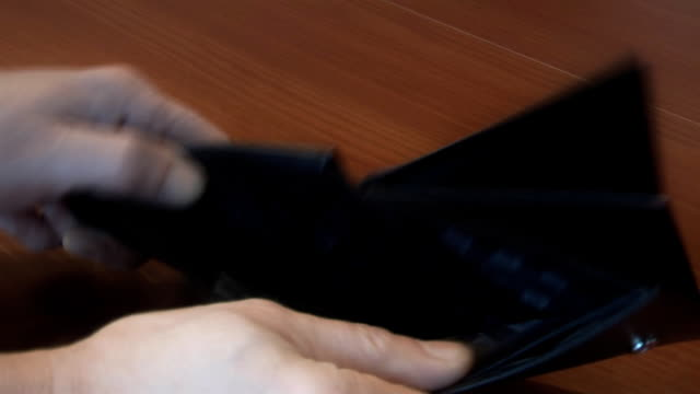 Man with his wallet , to illustrate the economy, consumption, financial crisis video
