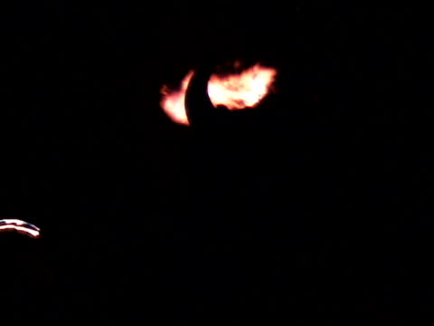 Man With Horns watching Flame Bursts at Night video