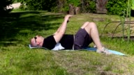 Man with overweight do exercises for flat stomach video