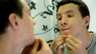 Man with Problem Skin queezing pimples video