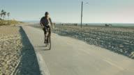 Man With Prosthetic Riding Bike Toward Camera video