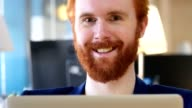 Man with Red Hairs Smiling  toward Camera in Office video
