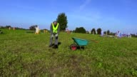 Man with shovel debris collect waste on hurdle field video