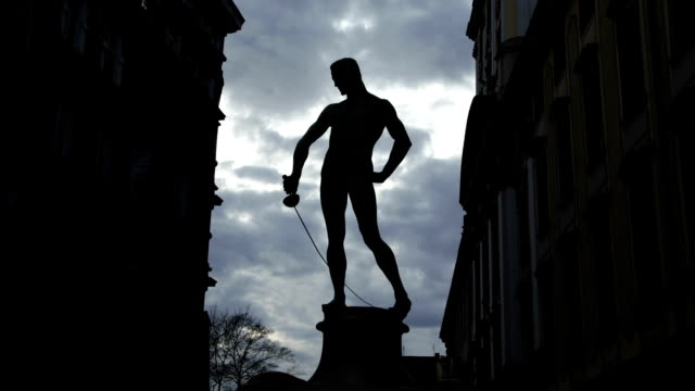 Man with sword in silhouette, Statue in backlight, University of Wroclaw, Poland, Eastern europe video