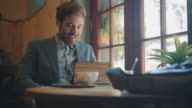 Man with tablet computer in cafe video
