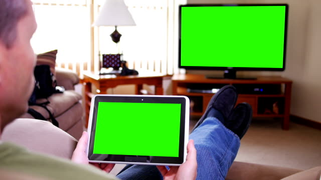 Man with iPad Watches TV video