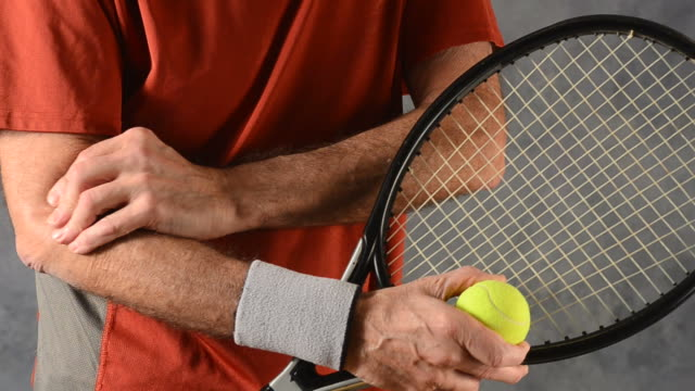 man with tennis elbow video