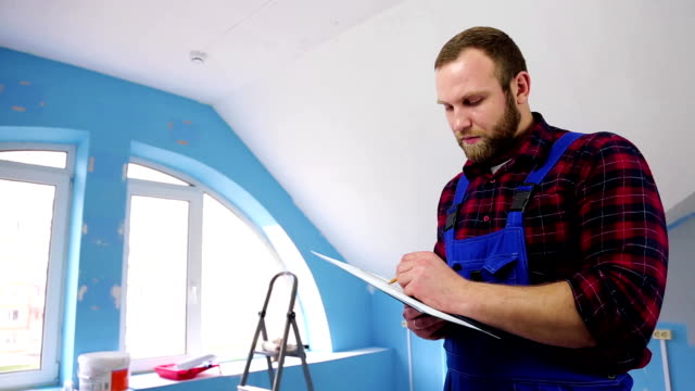 man with the drawing, in the repair room video