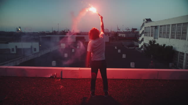 Man with torch on rooftop video
