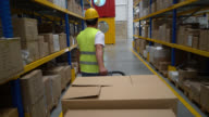 Man working at a warehouse using a manual forklift video