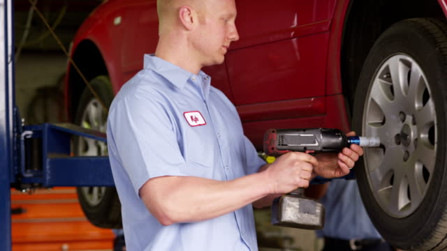 Man working in auto repair shop video