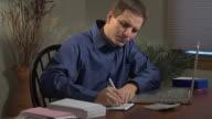 Man working on Home Finance crane shot video