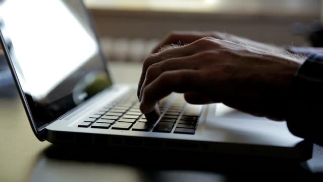 Man working on laptop, computer video