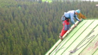 Man Working on the Roof, Checking Safety Gear video