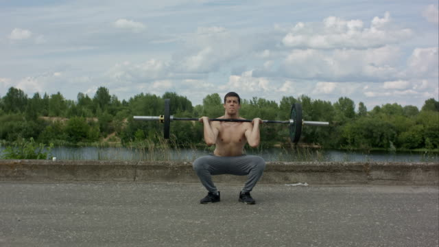 Man working out outdoors with barbell video