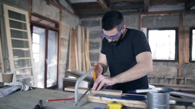 Man working with a saw video