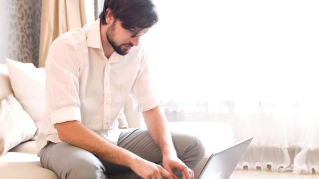 Man working with laptop video