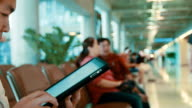 Man working with tablet at city airport video