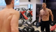 Man Working With Weights In Gym video