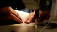 A man works for a sewing machine video