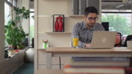 Man works in the coworking with laptop video