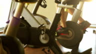 A man works out on an exercise bike late in the afternoon video
