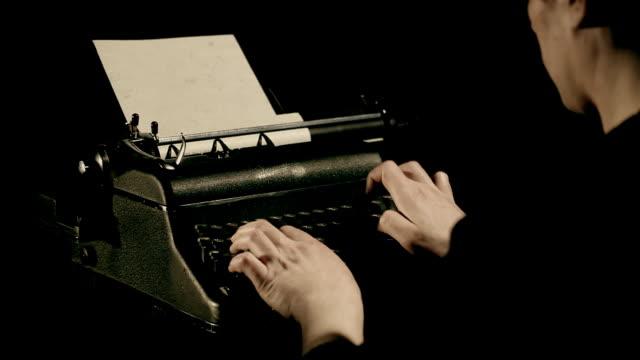 Man writing on typewriter video