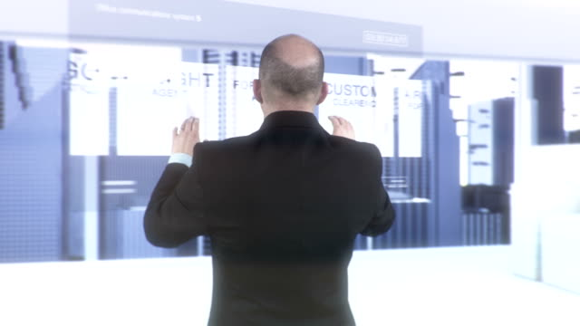 HD: Manager Doing Research On Futuristic Screen video