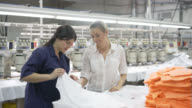 Manager giving instructions to operator of how to handle the fabric video