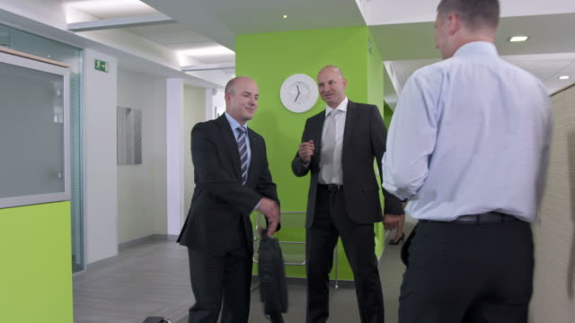 HD DOLLY: Manager Introducing New Employee video