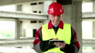 Manager of the works with electronic device at construction site video