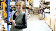 Manager smiling and holding tablet in warehouse video