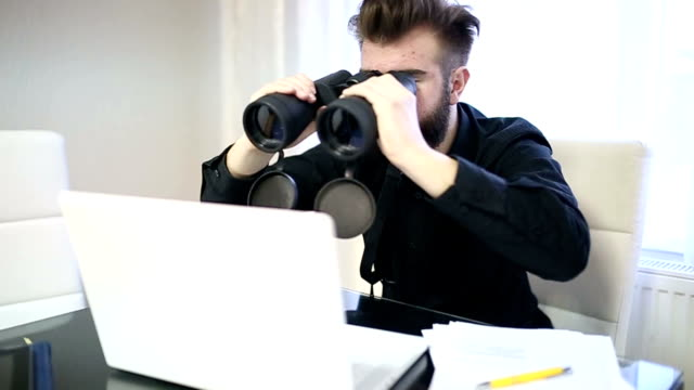 Manager with binoculars video