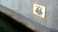 Manatee Zone boating sign on Florida canal video
