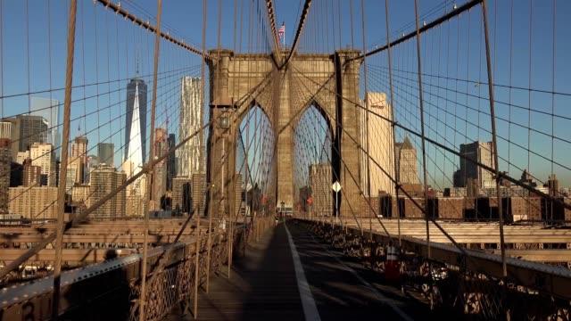 Manhattan Bridge and Brooklyn Bridge in New York City, USA. Beautiful NYC Timelapse. Brooklyn Bridge with cars in traffic and people. Suspension bridge that connects Manhattan to Brooklyn. video