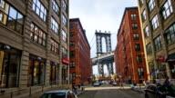 Manhattan Bridge seen between buildings in New York city video