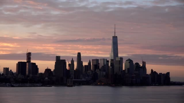 Manhattan Downtown panorama skyscrapers at evening, night, New York City NYC Skyline. Apartments Buildings. The skyline of New York City at Sunset filmed from the the New Jersey. video