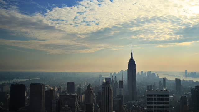 Manhattan skyline time lapse with sunbeams video