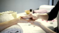 Manicure and applying hand moisturizer video