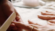 Manicurist Shaping Nails video