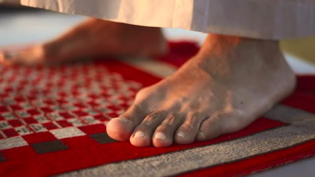 HD: Man's Feet On A Prayer Mat video