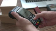 Man's hand pushing the button and swipe credit cardterminal video